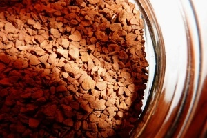 pure, natural, and dark cocoa powder in a cup of warm water